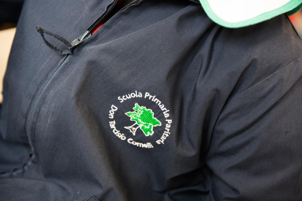 scuola don Comelli vigevano logo